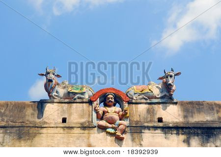 God and two cows on wall of Sri Meenakshi hindu temple in Madurai, India