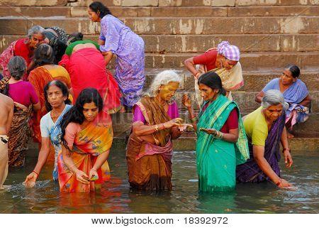 colorful hindu women bathing in the ganges in varanasi