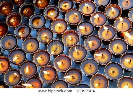 Candles at swayambhunath temple in Kathmandu, Nepal