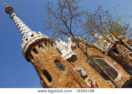 Ginger bread house with tower designed by Gaudi in Park Guell, Barcelona