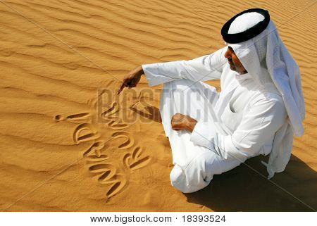 Traditional arabic man writing in the sand in Wadi Rum desert, Jordan