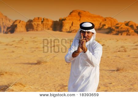 Arabic Man Point And Shoot With His Hands In Wadi Rum Desert At Sunset, J