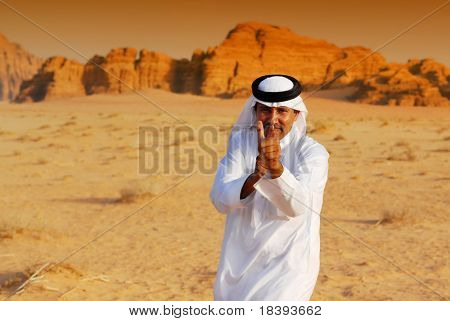 Funny Arabic Man Playing By Point And Shoot With His Hands In Wadi Rum Desert At Sunset, J