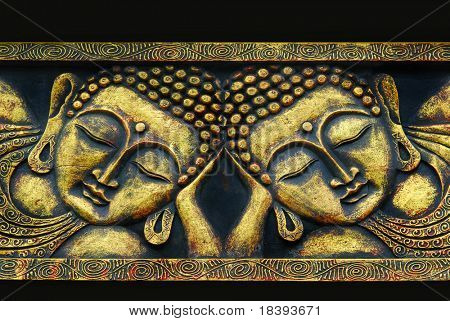 Golden south east asian buddha faces on black background