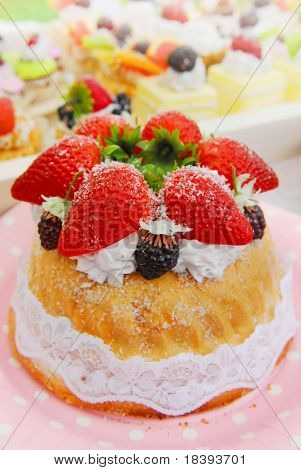 Strawberry cake and soft background filled with colorful cakes and desserts with fresh fruits