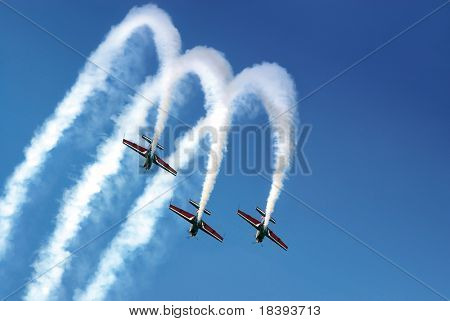 Aerobatic team making loopings in the air
