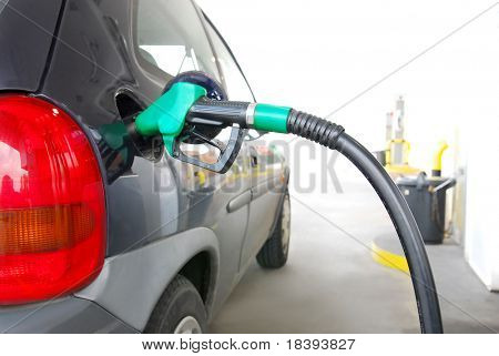 Filling up gas at fuel pump