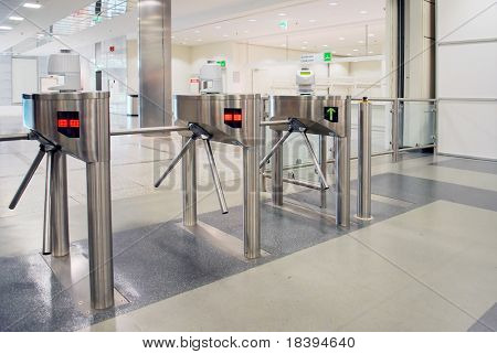Turnstile entrance and exit gates at big event or trade center