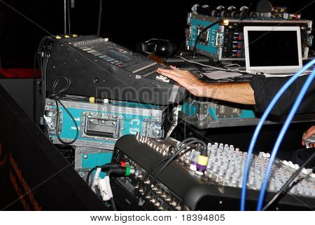 Audio and video mixing console operated by man