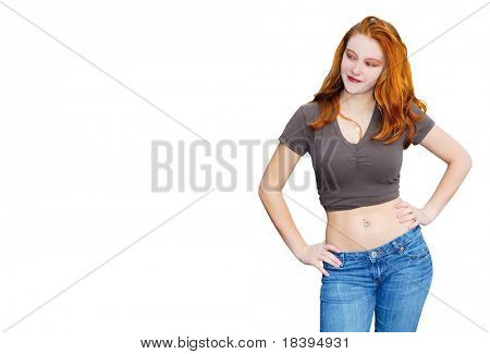 Caucasian young woman with red long hair and navel piercing isolated on white background