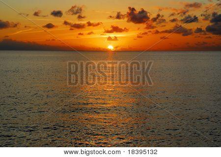 Sunset or sunrise over the ocean at Maria la Gorda beach, Cuba