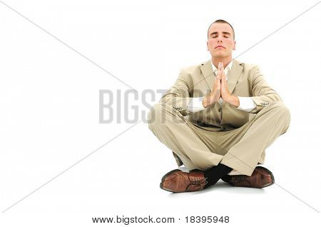 Businessman sitting in buddhist praying position to get rid of office stress, isolated on white background