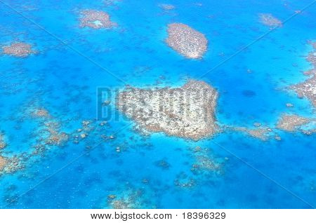 Natural heart shaped coral island in Great Barrier Reef near Cairns, Australia seen from above