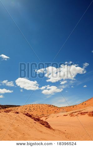 Orange desert and blue sky outside Antelope canyon, Arizona