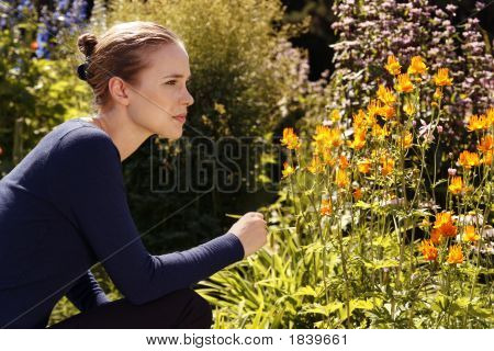 Woman Looking At Flowers