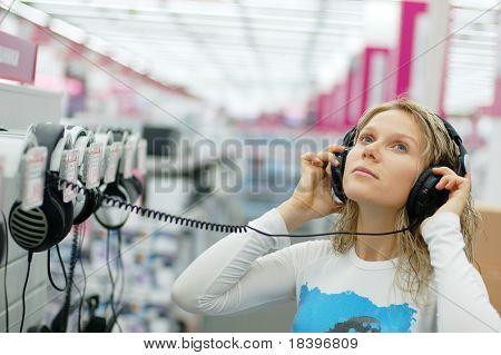 girl listening music  in store