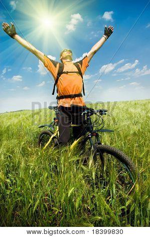 biker in green summer field