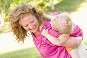 pic of mother child  - Mother and Daughter Piggyback Ride in the Park - JPG
