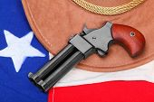 foto of derringer  - Double derringer pistol on a american flag - JPG