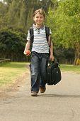 stock photo of children walking  - boy walking to school - JPG