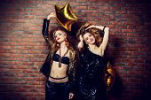 Two glamorous sexy girls at a night party. Beauty, fashion. Entertainment. poster
