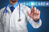 Word HEALTHCARE and doctor on background poster