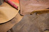 Leather craft. Colorful pieces of beautifully colored or tanned leather on leather craftmans work d poster