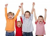 pic of happy kids  - Happy kids with their hands up isolated on white - JPG
