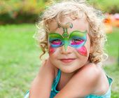 foto of face painting  - Beautiful girl with a body painting - JPG