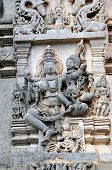 stock photo of belur  - Ancient sculptures in ruins at an indian temple - JPG