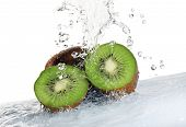 kiwi fruit being washed isolated on white