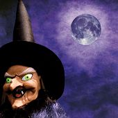 stock photo of minx  - scary halloween witch on grunge purple background and full moon - JPG