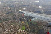 view from a plane on wing and on rural england (near heathrow airport, london)