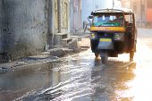 stock photo of rickshaw  - motor rickshaw in jaipur after monsoon or flood - JPG