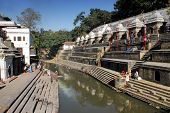 Cremation gaths at Bagmati river in Pashupatinath poster