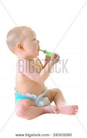 Little baby girl with teething brush