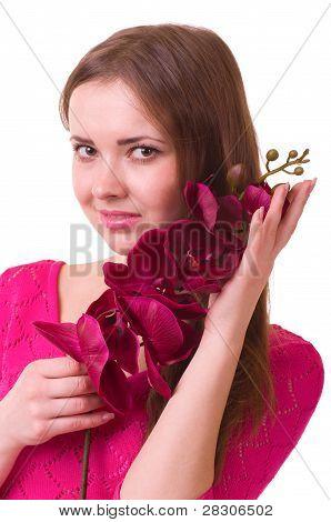 Hermosa joven con Orquídea sobre fondo blanco.