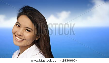 beautiful asian young woman with blue ocean background