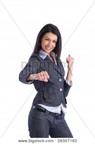 Caucasian businesswoman in a suit ready for a fight.