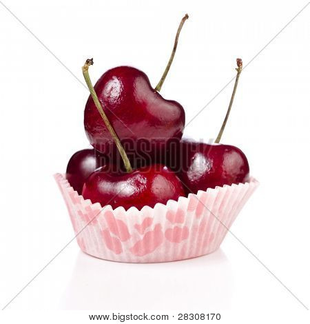 Red ripe cherries in a paper bowl isolated on white background