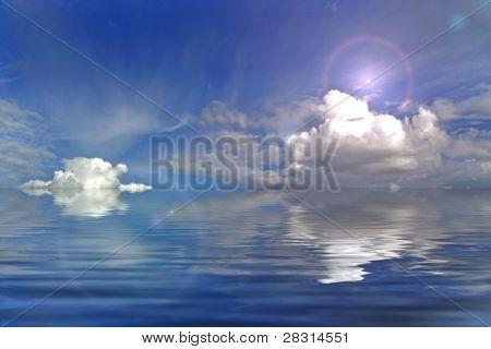 clouds reflecte in the water and the sun with flare