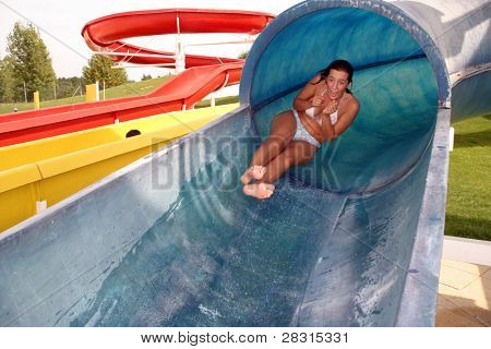 girl in swimming pool water slide