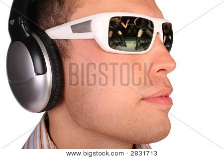 Young Man With Sunglasses And Headphones Half-Turned