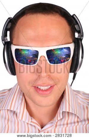 Young Man With Sunglasses And Headphones