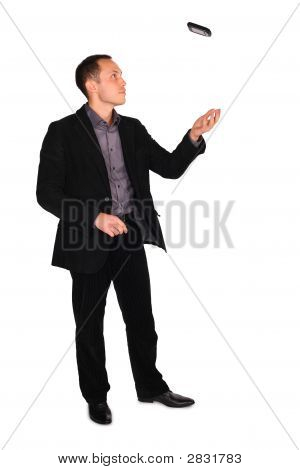 Young Businessman Plays With Cellphone