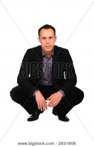 Young Businessman Sits