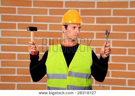 Portrait of a worker,over brick wall
