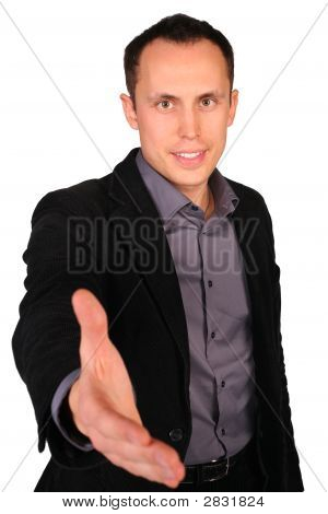 Young Businessman Gives Hand