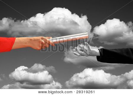 hands passing the baton, business and sports theme