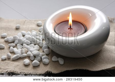candles and massage stones in a calm zen spas
